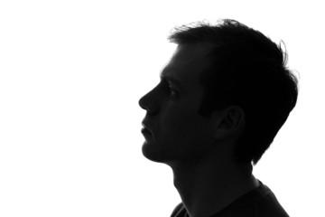 black-and-white portrait of a sad man