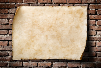 old parchment on aged brickwall