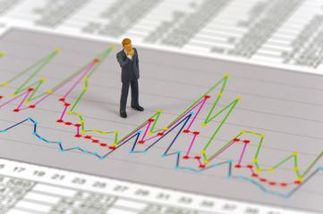 Banker mit Chart und Börsenkurs