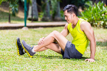 Asian man stretching in fitness exercise