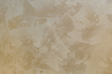 Background texture of beige gold plaster walls