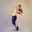 Young pretty Caucasian hip hop girl dancing with fun
