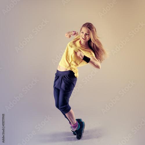 Fotobehang Dans Young pretty Caucasian hip hop girl dancing with fun