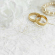Two golden wedding rings with seamless flower decorations - 81880337