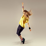 Fototapety Zumba dance workout. Young sporty woman dancer in motion.