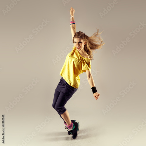 Zumba dance workout. Young sporty woman dancer in motion. Poster