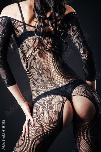 Sexy beautiful naked woman in black erotic lingerie on dark - 81881392