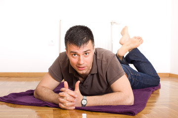 Man lying on the floor on stomach