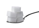 kostka cukru a lžíci sladké sladidlo