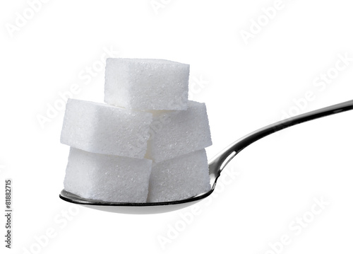 Foto op Plexiglas Dessert sugar cube and spoon sweet sweetener