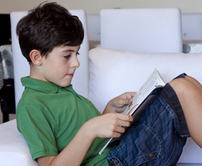 Young Boy is Reading a Book