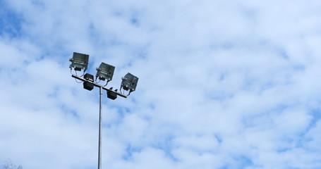 Spotlight, Stadium lights, with blue sky timelapse 4k