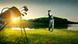 Leinwandbild Motiv Golf. Golfer makes a strong kick of the ball.