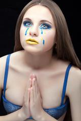 Woman praying with tears.