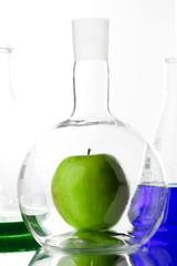 Apple in beaker