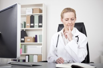 Thoughtful Physician with Index Finger on Lips