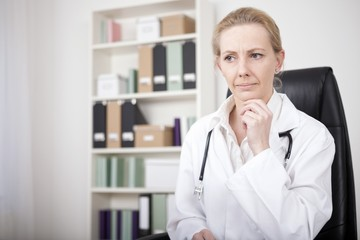 Pensive Female Doctor with Hand on her Chin