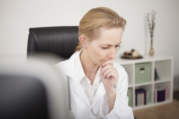 Pensive Blond Female Clinician Looking Down