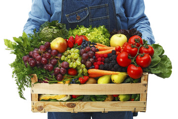 Farmer holding box with fruits and vegetables