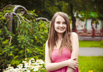 smiling woman on a walk in the garden