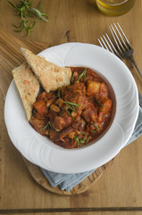 Spiced sausage and cannellini stew