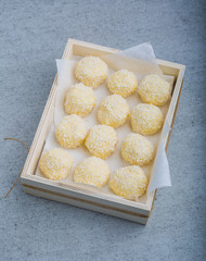 Homemade Coconut Pralines in a wooden box.
