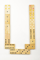 Alphabet letter U arranged from wood dominoes tiles isolated