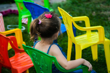 Children on party colors chairs