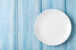 Empty plate on blue wooden background - 81888386