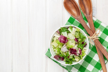 Fresh healthy salad over white wooden table