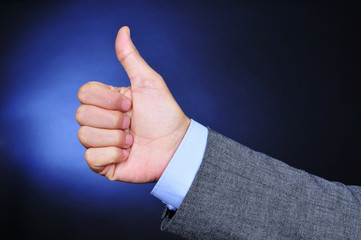 young businessman giving a thumbs-up sign