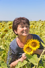 Woman with sunflowers
