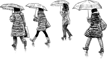 women under umbrellas