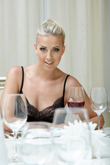Seductive blonde resting with glass of wine