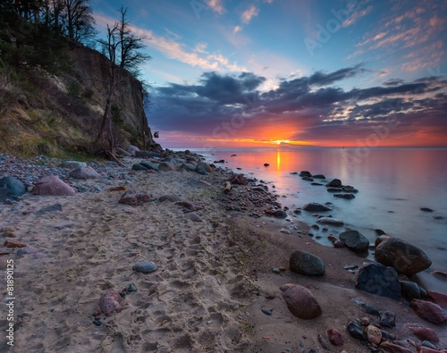Plexiglas Kust Cliff on sea shore at sunrise. Baltic sea long exposure photo