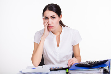 Upset business woman thinking