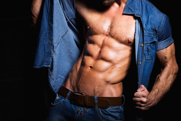 Muscular and sexy body of young sport man in jeans shirt
