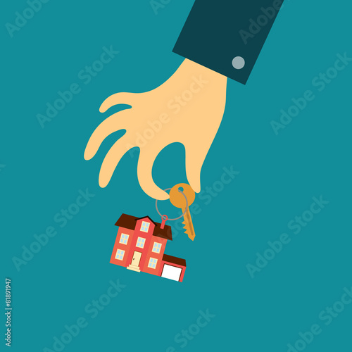hand of a real estate agent holding a key with a tag in the form - 81891947