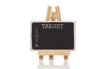 Target drawn with chalk on blackboard