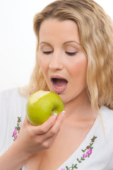 Young housewife with green apple