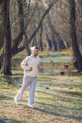 Young man jogging in beautiful nature