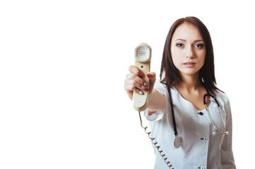 Woman in scrubs holding a telephone