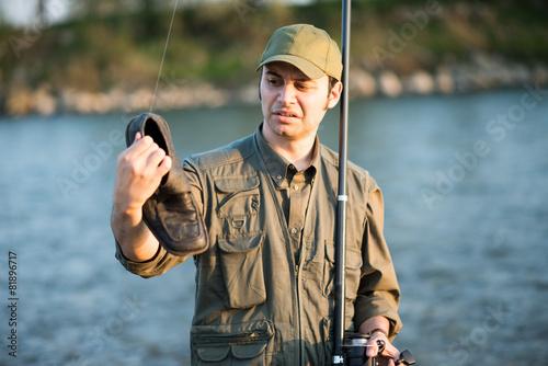 Fisherman fishing on a river