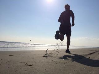 Silhoette of man running on beach