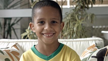 Cute Brazilian boy at home