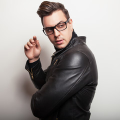 Elegant young handsome man in black leather jacket