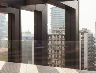 Cityscape seen from interior of modern building