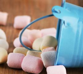 Sweet marshmallows in a bucket.