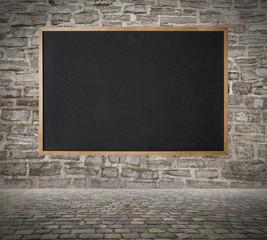 Blackboard on the wall background.