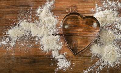 Flour and Heart-shaped cookie cutter
